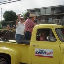 Leslie waving to the crowd, Makawao Parade 2014